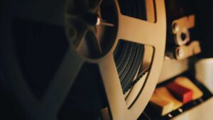 Old 8mm film projector playing in the night