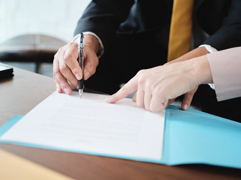 business insurance signing documents