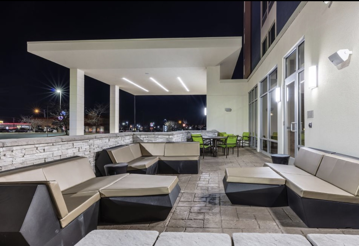 Remodeled commercial outdoor patio with replaced lighting