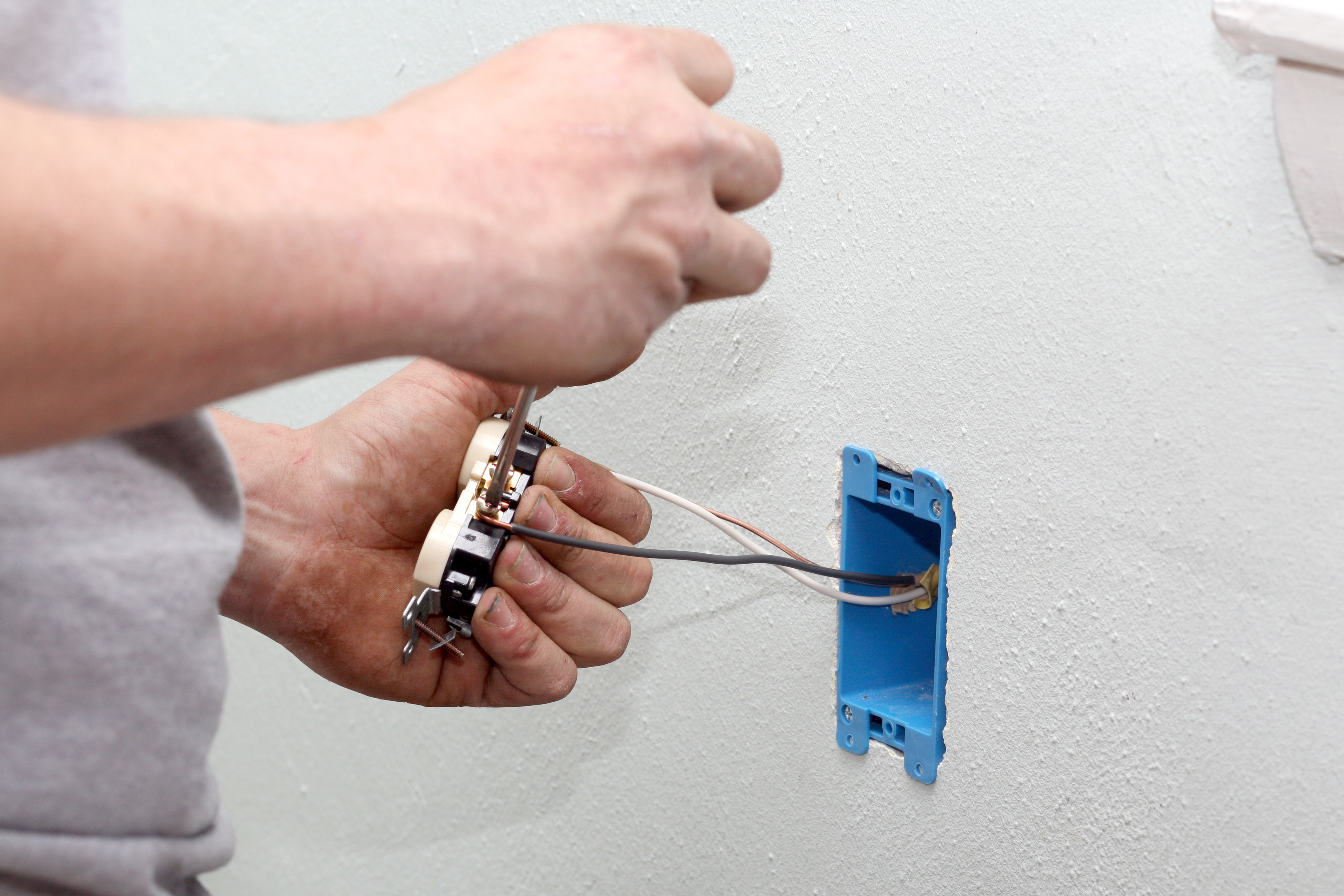 Electrical outlet being installed by a electrician.