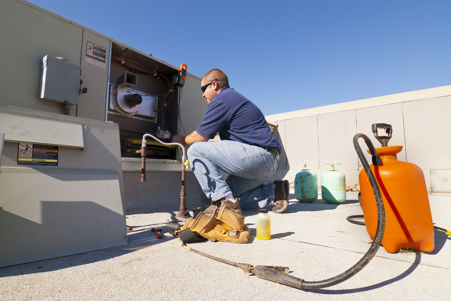 HVAC-Tech-Working-on-Roof
