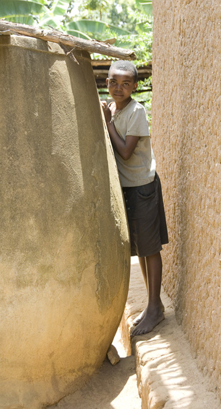Millennium Villege - Mayange, Rwanda.  Girl and Cistern