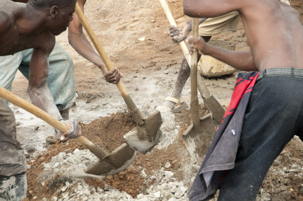 Mixing ingredients to make cement for the 2nd floor of Kigali Parents Secondary School.