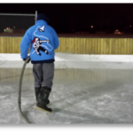 Volunteer flooding the rink