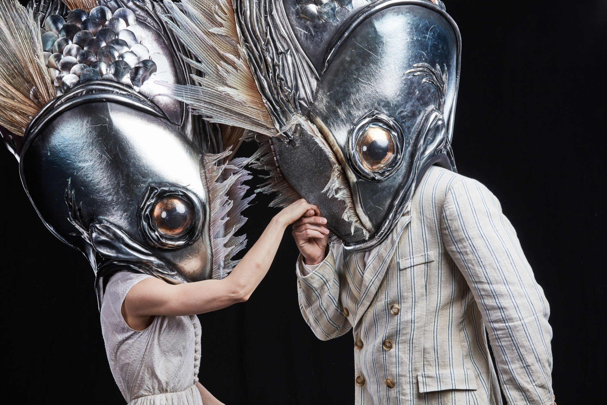 dancers in giant fish heads