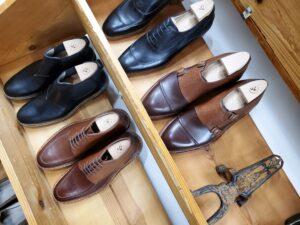 a shelf of bespoke shoes by amy slosky