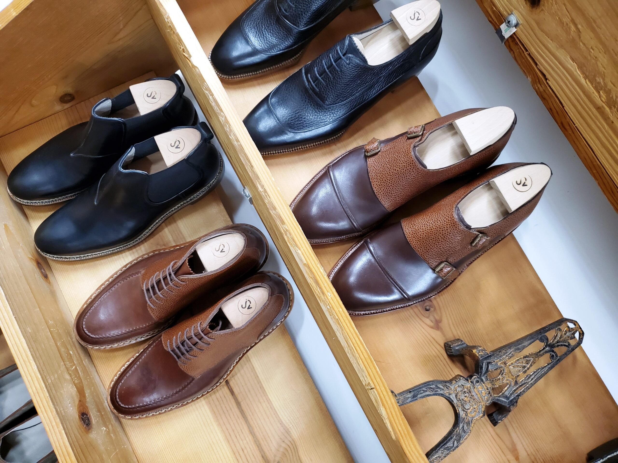 a shelf of bespoke shoes by amy slosky