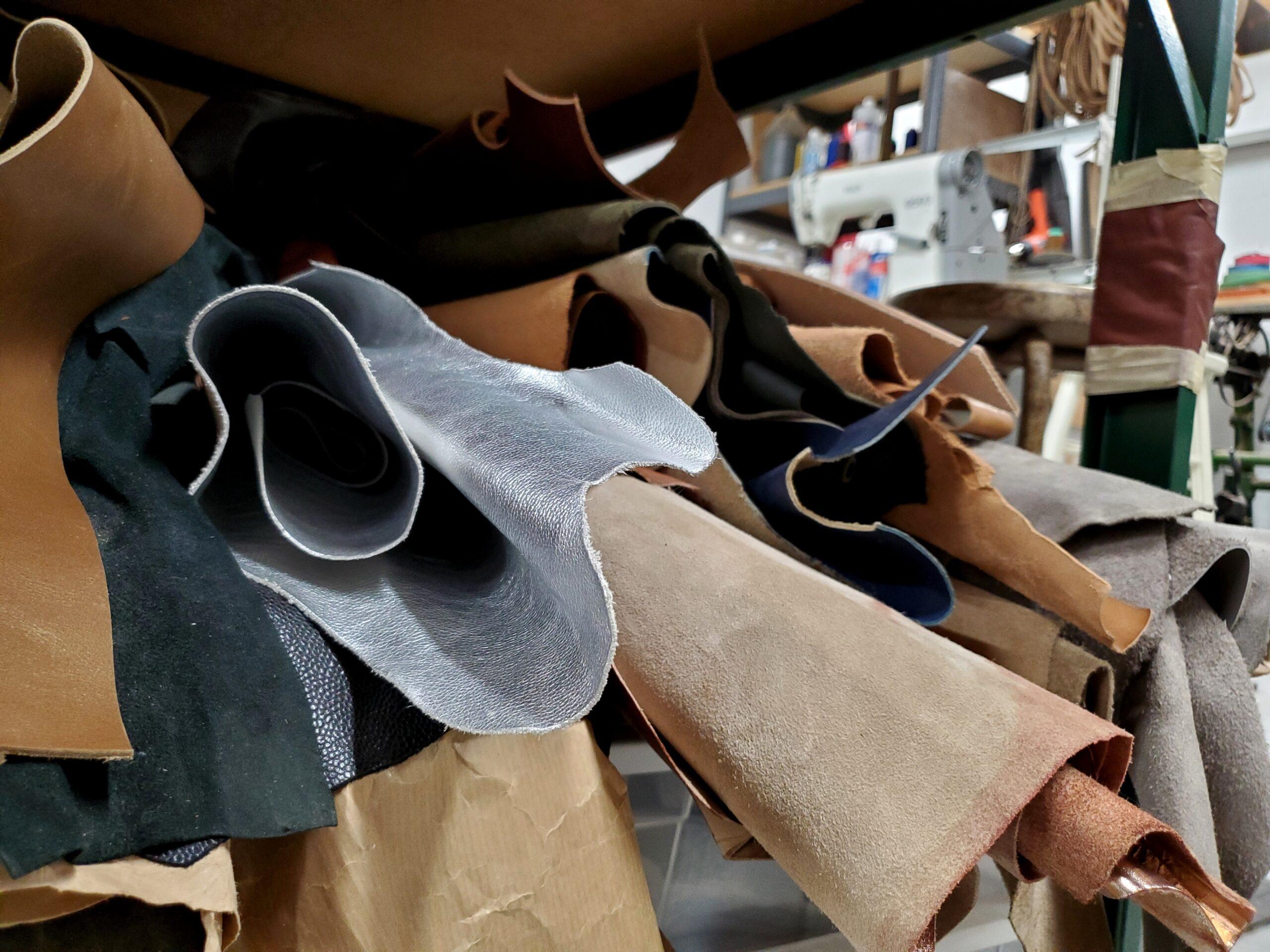 rolls of leather in shoemaker studio