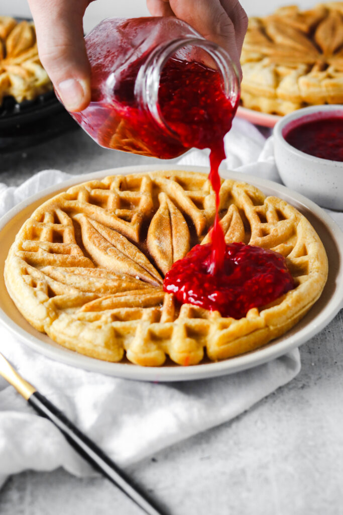 Nutella stuffed waffle with raspberry compote