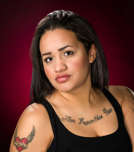 Professional portrait of woman with tattoos