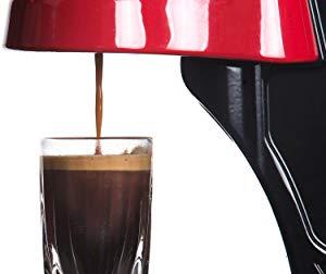 Closeup demonstration of the Flair manual, hand pump espresso maker with a thick prema, Flair Espresso machine