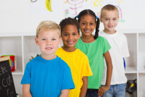 happy preschoolers in a row