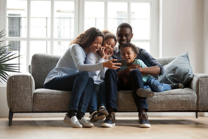 Family Using Alarm System on Smartphone