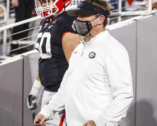 Georgia head coach Kirby Smart and Georgia offensive lineman Warren Ericson (50) before a game against Mississippi State on Dooley Field at Sanford Stadium in Athens, Ga., on Saturday, Nov. 21, 2020. (Photo by Tony Walsh)