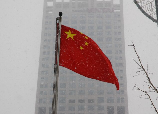 Chinese Flag In Front Of Building