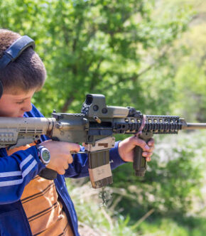Kid At Shooting Range