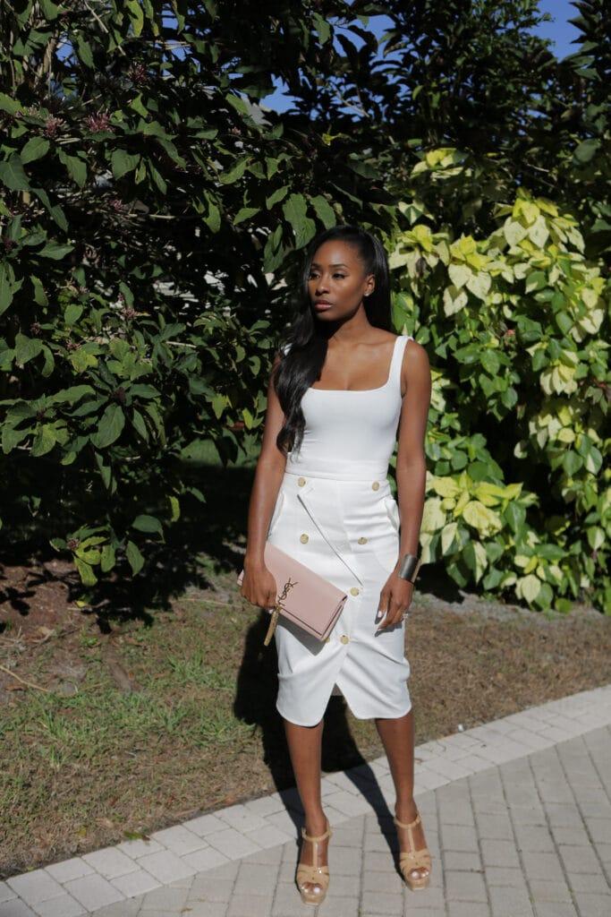 white bodysuit and midi length skirt
