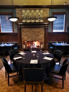 Crave main event room set for a dinner event.