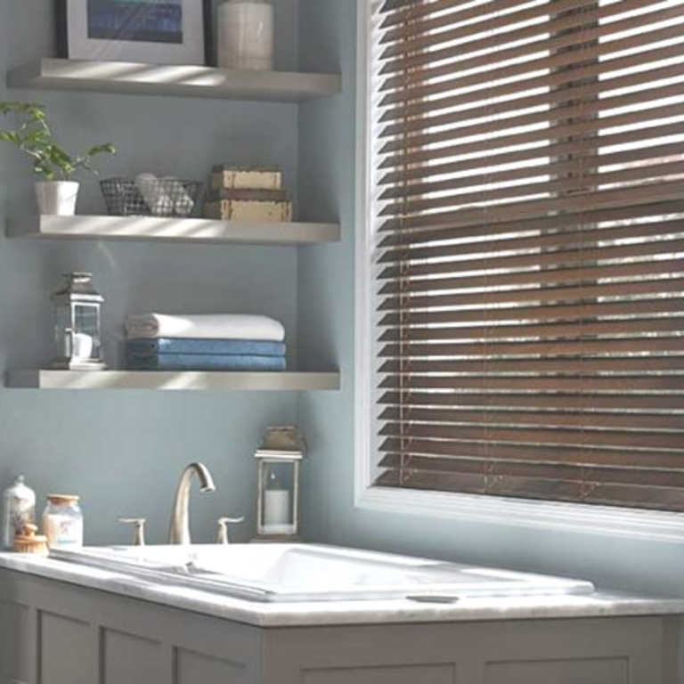bathroom with wood blinds