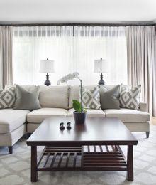 comfortable living room showcasing sheer draperies