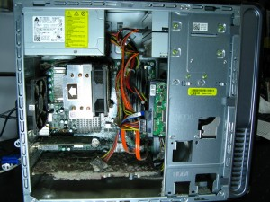 Inside a dirty ATX style computer with a failed poser supply.