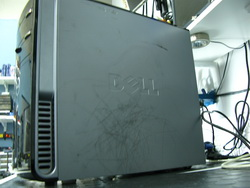 Dirty scraped up computer case.