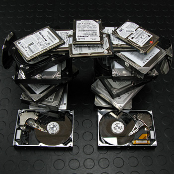 pile of broken hard drives