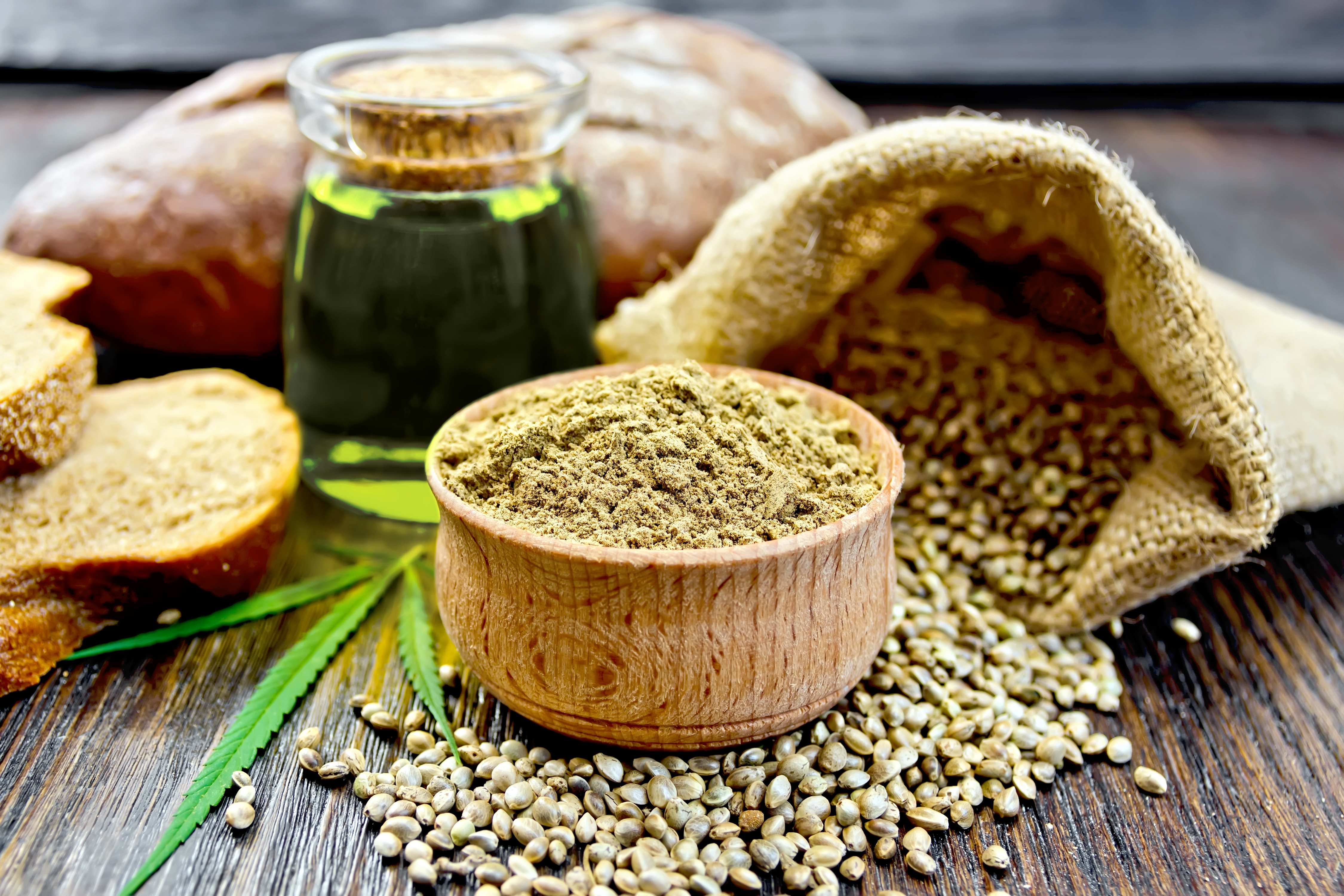A bowl of hemp seeds and cbd oil used for helping patients