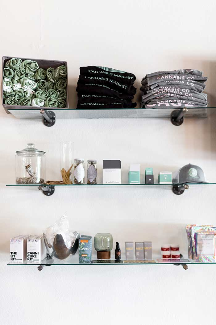 Shelves with Sage Wellness products