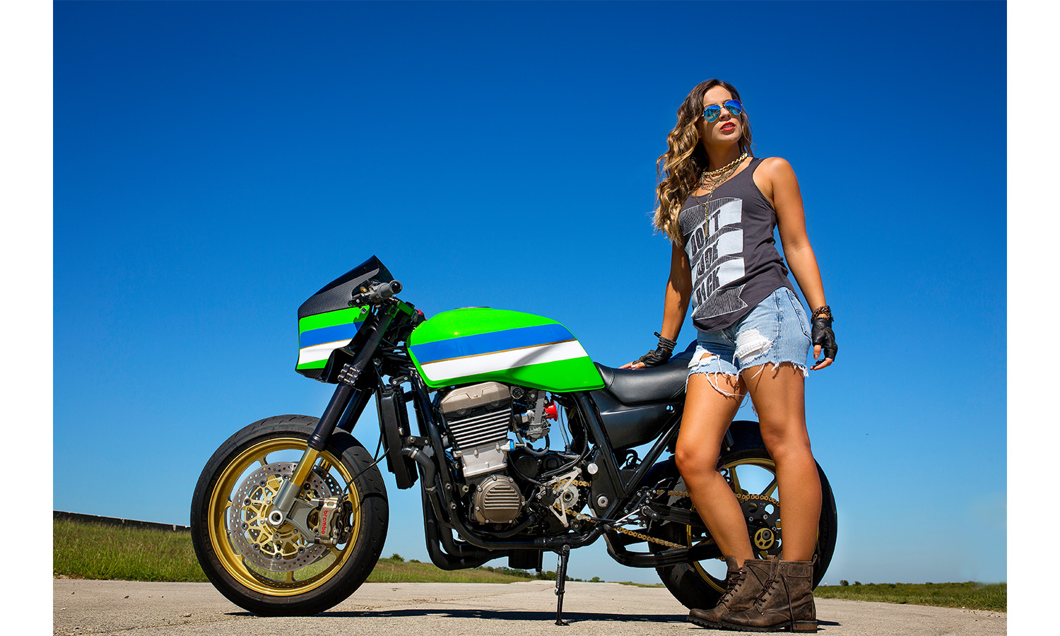 portrait of woman with motorcycle
