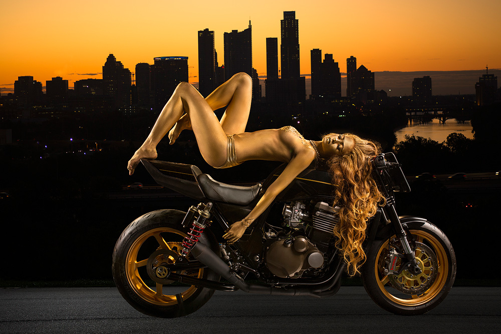 gold body paint model on motorcycle