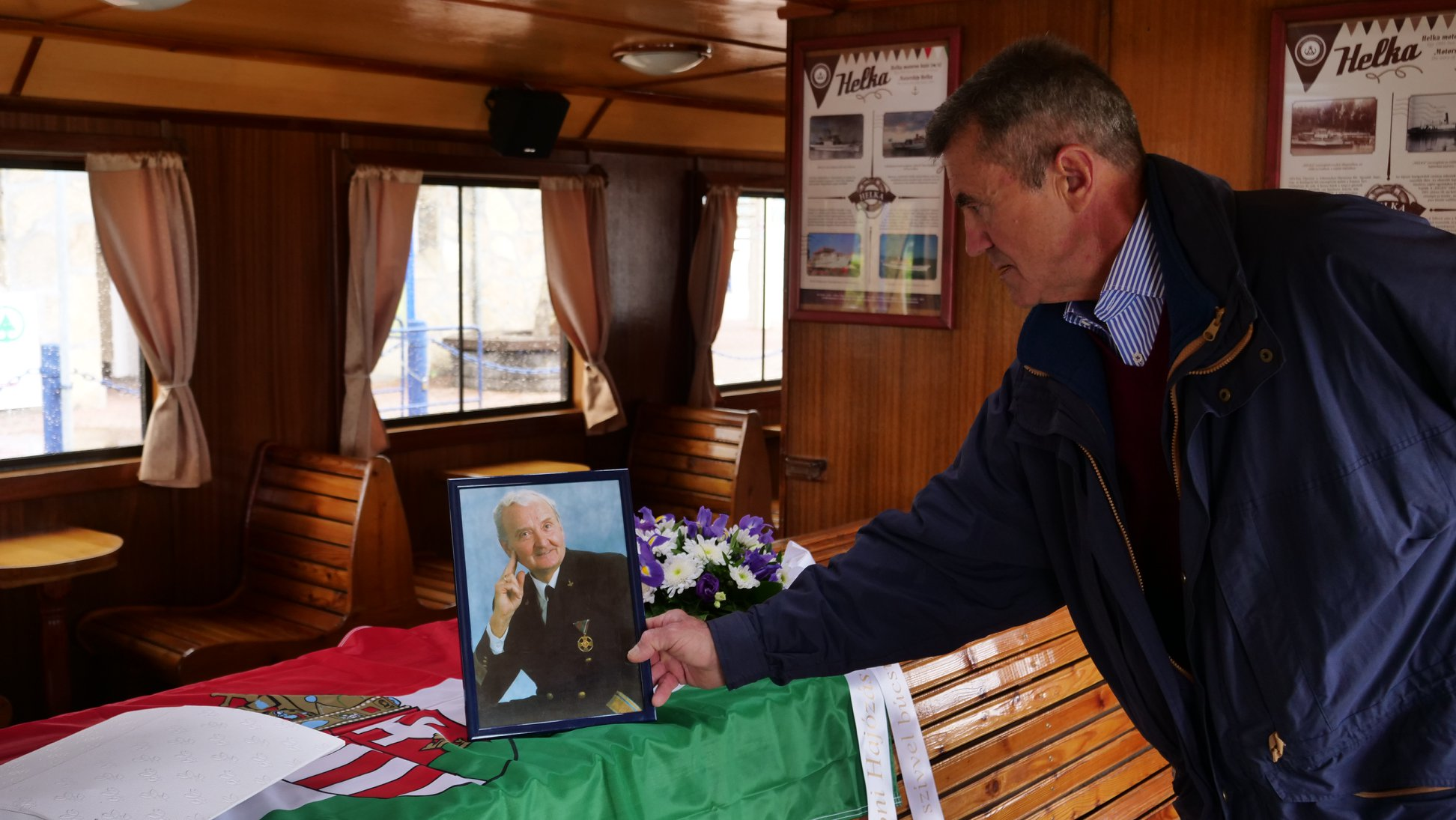 Istvan with father's photo and ashes