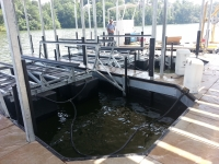 Double slip dock with concrete decking