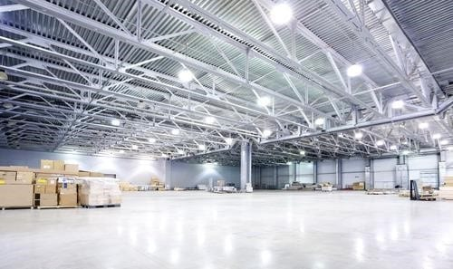 A commercial electrician in a warehouse space in Spokane