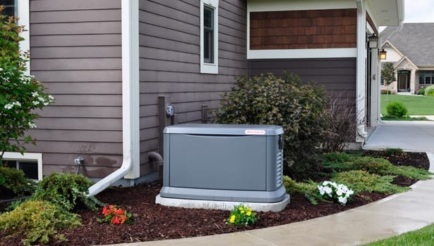 A whole home backup generator by Generac powering a residential home.