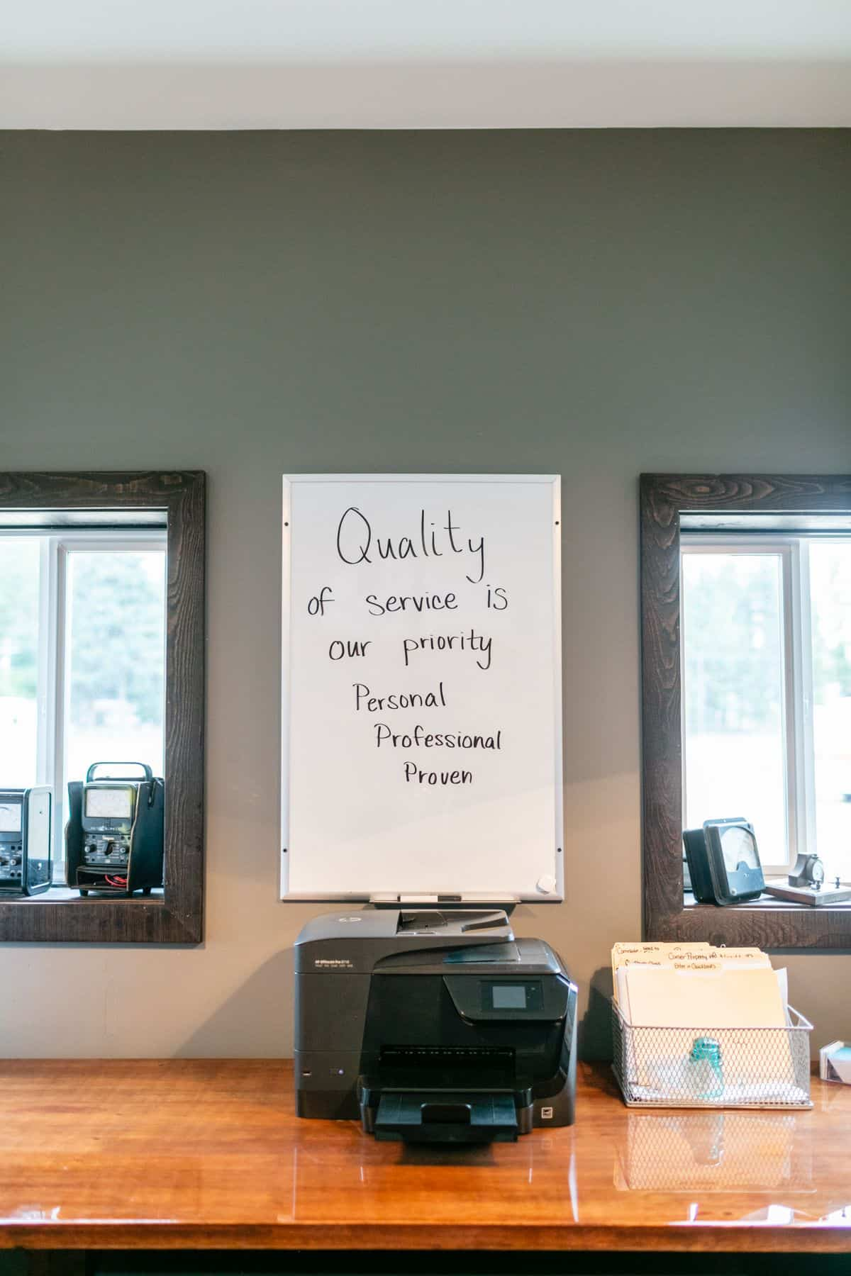 quality electricians in Spokane_quality of service is our priority written in black on a white board_VPC Electric quote