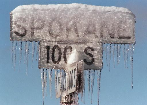Spokane street sign covered in ice