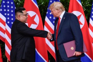 Trump and Kim Shake Hands For History