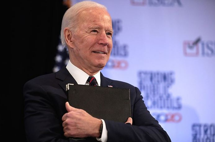 Joe Biden Standing With Clip Board