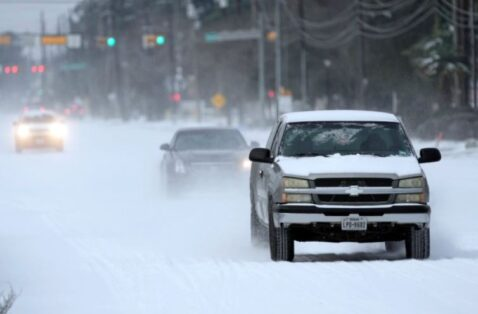 Pickup Truck Driving In Snow