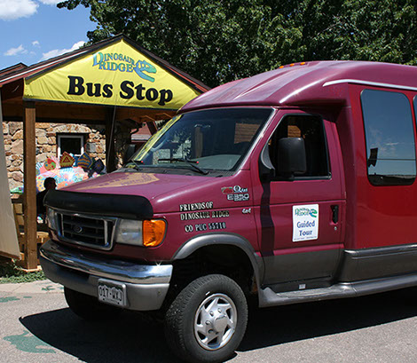 Picture of Dinosaur Ridge tour bus at public tours bus stop