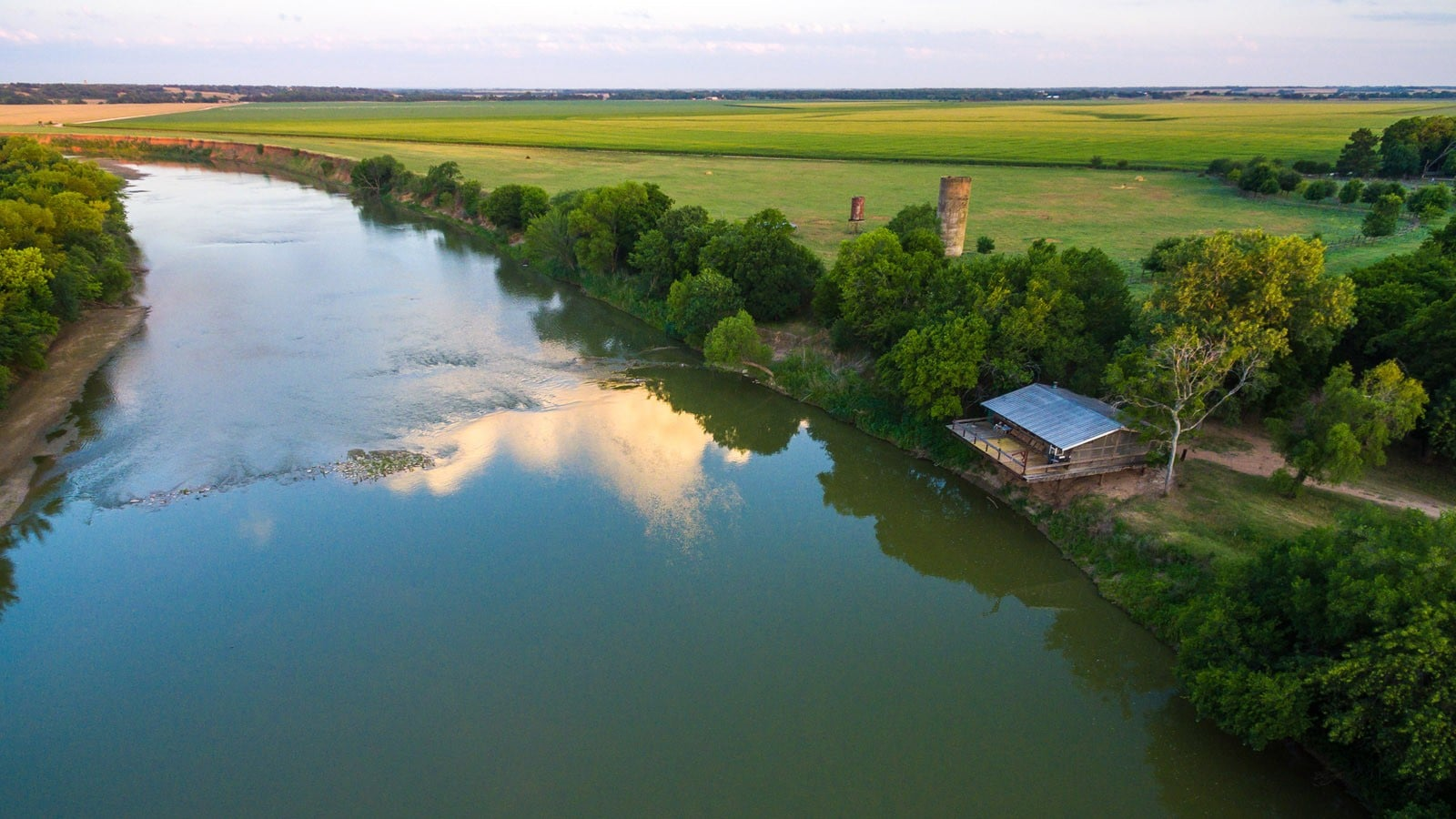 aerial view of boathouse overlooking broad river