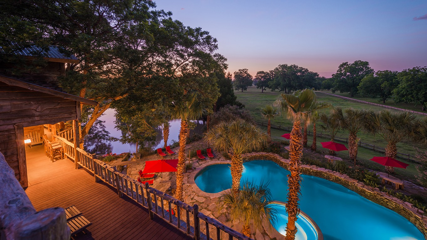 pool area from main house upper deck during sunset