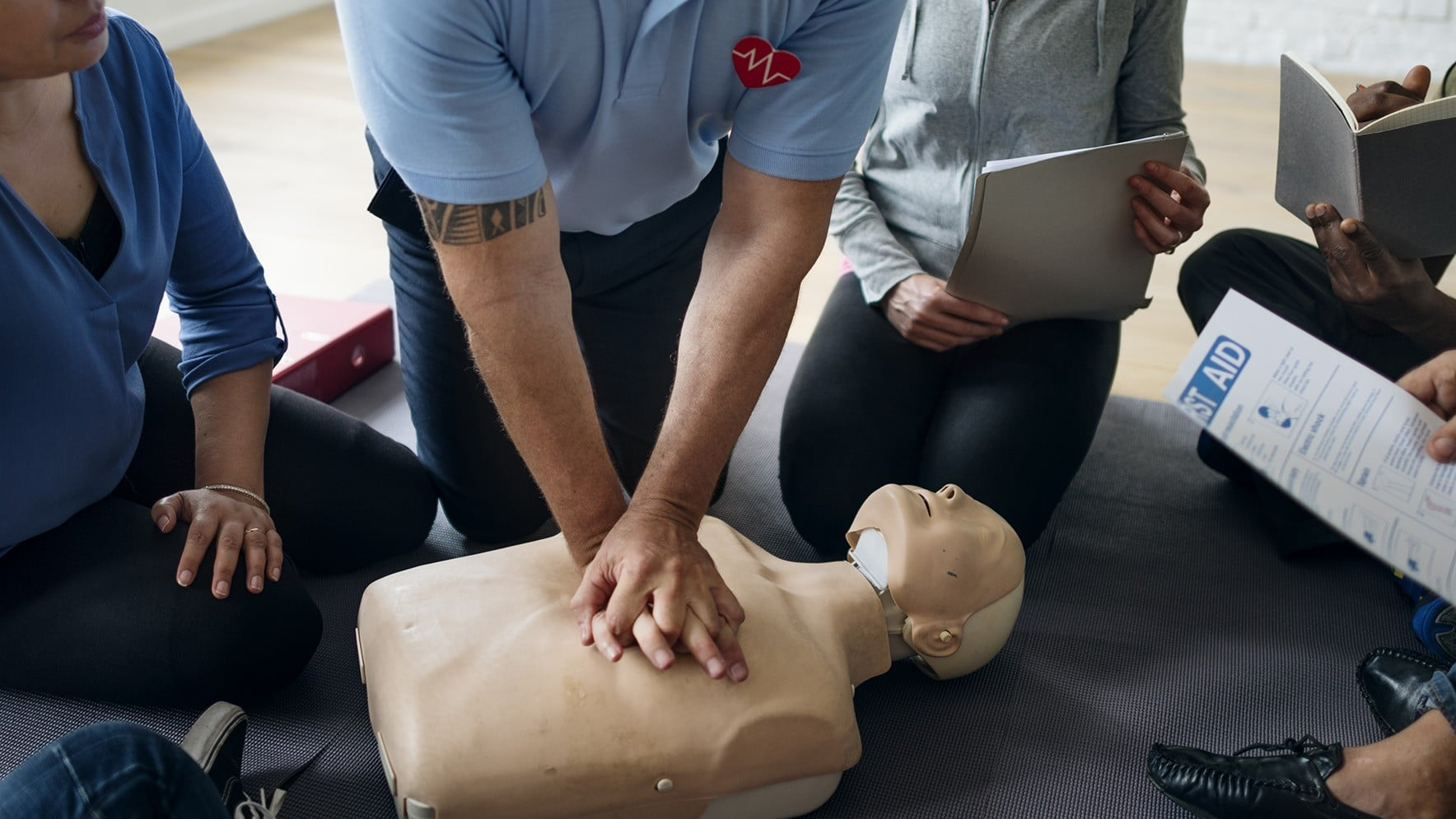 group of people learning first aid