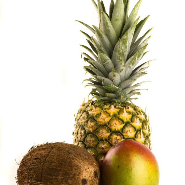 2986566 – tropical trio – pineapple, mango and coconut isolated on white
