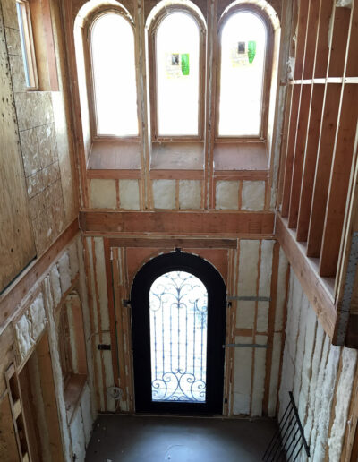 Insulated Walls in two-story entrance foyer in Custom Home