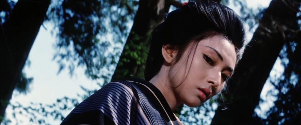 lady snowblood looking down at victim - top 10 best samurai movies