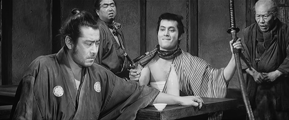 yojimbo sitting at table - top 10 best samurai movies