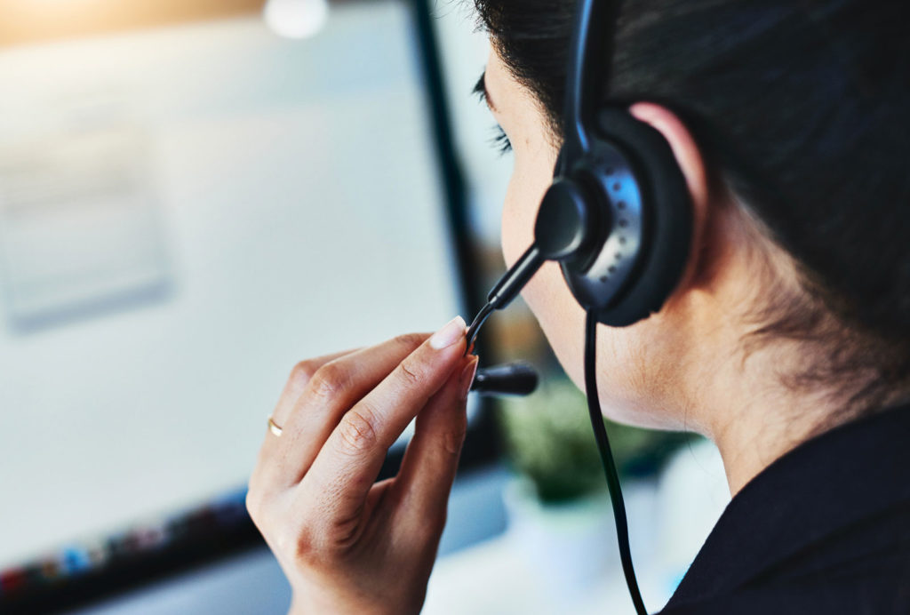 An image of a support person on the phone