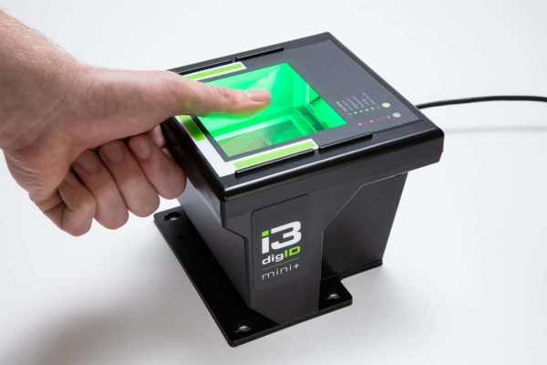 A photo of a digID mini+ in use, scanning a thumb
